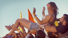 In high quality format happy hipster woman crowd surfing Stock Footage