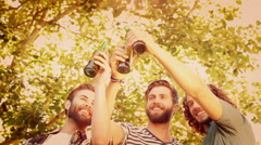 Hipsters toasting with beer bottles - stock footage
