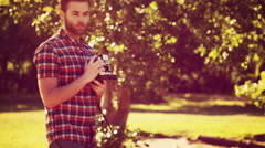 Stock Video Footage of In high quality 4k format handsome hipster with retro camera