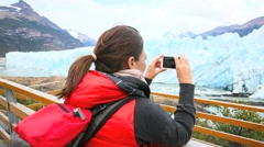 Tourist taking picture of Perito Moreno Glacier Stock Footage