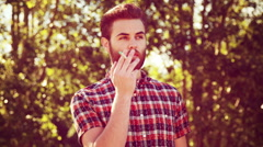 In high quality 4k format handsome hipster smoking an electronic cigarette Stock Footage