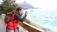 Tourist taking picture of Perito Moreno Glacier - stock footage