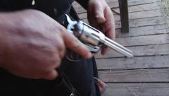 Outlaw draws gun, twirls, re-holsters Stock Footage