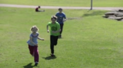 Children running on the grass - stock footage