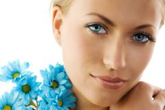 Blue eyes and blue daisy Stock Photos