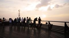 Tourist Watching Sunset At Langkawi Cable Car Top Platform, Pan Right Stock Footage