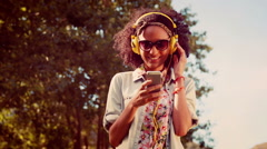 In high quality 4k format pretty hipster using her smartphone - stock footage
