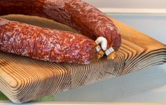 Salami in the refrigerator with the door open Stock Photos