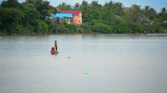 Fishermen Rowing on the Stung Sen River in Cambodia Stock Footage
