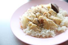 Thai food gourmet steamed chicken with rice , khao mun kai in wood background Stock Photos