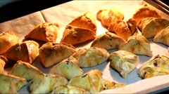 Homemade prune hamantashen in a hot oven immediately after baking 1 Stock Footage