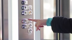 Button click in the lift - stock footage