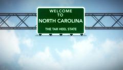 4K Passing North Carolina USA State Border Welcome Road Sign with Matte 2 sty Stock Footage
