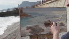 Artist paints in oils Stock Footage