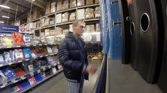 A man in the stationery department store Metro Cash & Carry Stock Footage
