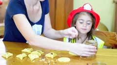 Jewish Mother and her child preparing Hamantaschen cookie cooking in Purim Ho Stock Footage