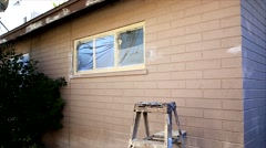 Painting Process of a house. - stock footage
