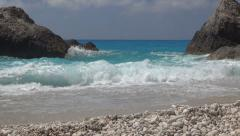 White sparkling sea waves on the seashore. Beautiful beach with sand and cliffs. Stock Footage