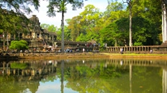 Tourists Strolling among Ancient Ruins at Angkor Wat Stock Footage