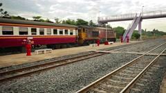 Old Diesel Locomotive Pulling Passenger Train in Thailand Stock Footage