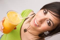 Attractive Woman Intimate Portrait Drinking Orange Fruit Smoothie Stock Photos