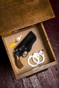 38 Revolver Gun Holster Desk Drawer Key Handcuffs Restraints - stock photo