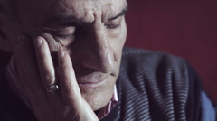 old man portrait: melancholy, pensive, depressed, painful - stock footage