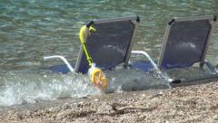 Chairs with diving equipment staying in water sea. Relaxing place on the beach. Stock Footage