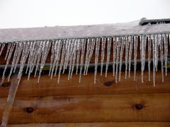 Roof with icicles - stock photo