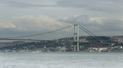 Time lapse clouds moving across the blue sky with Bosphorus Bridge Stock Footage