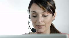 call center operator: young woman working with computer and headset - stock footage
