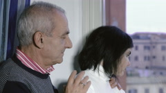 Father and daugther: old father console his depressed daughter Stock Footage