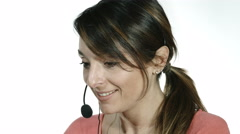 Smiling call center operator with white background Stock Footage