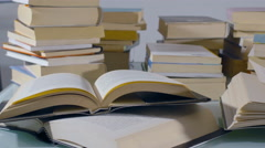 Stacked books on the table: tracking shot Stock Footage