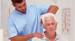 Physiotherapist examining shoulders of patient - stock footage