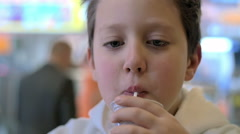 Slow motion of a child at the fast food restourant  Stock Footage