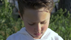 Kid making bubble blower: slow motion footage Stock Footage