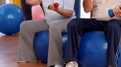 Trainer helping senior citizens work out Stock Footage