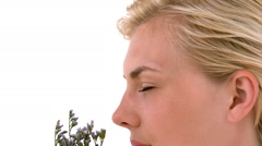 Blonde woman smelling dried lavander Stock Footage