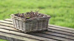 Wicker basket on the wooden table - stock footage