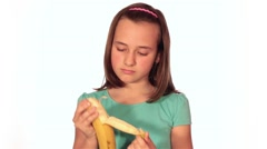 Beautiful Little Girl Jaw And Eating A Banana On A White Background Stock Footage
