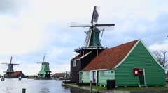Dutch Windmill in rural landscape Stock Footage