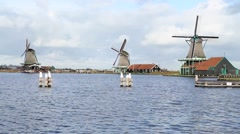 Row of three windmills in Holland Stock Footage