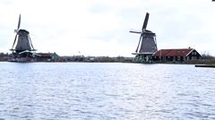 Two windmills working, Holland Stock Footage