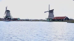 Two windmills working in The Netherlands Stock Footage