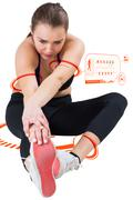 Stock Illustration of Composite image of fit brunette stretching her leg
