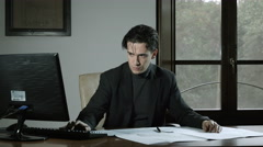 nervous and worried businessman at work - stock footage