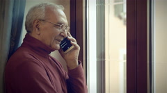 old man having a conversation with a smartphone - stock footage