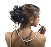 Woman dressed only in strings of pearls Stock Photos