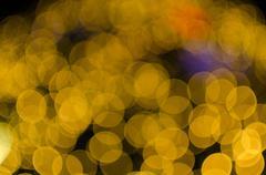 Night light Yellow bright bokeh background - stock photo